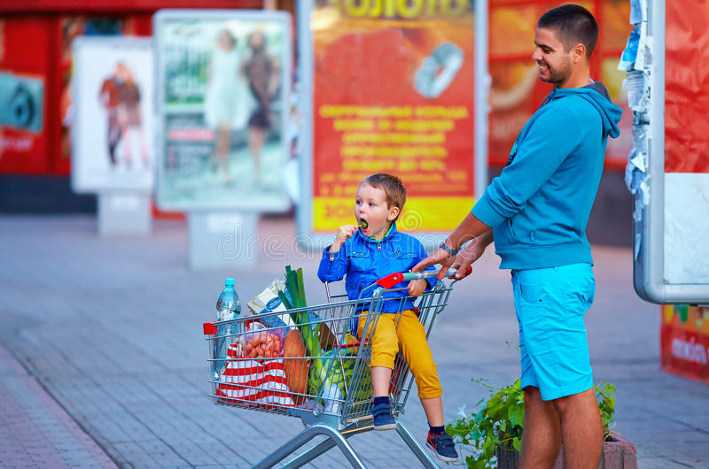 Download Father And Son With Trolley After Shopping Stock Image - Image: 34116213