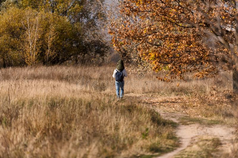 Father an son walking in the park in Kiev, Ukraine. Warm and sunny autumn in Kiev, Ukraine royalty free stock photos