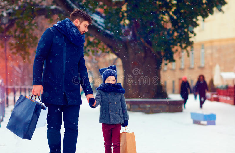 Father and son walking on winter shopping royalty free stock photography