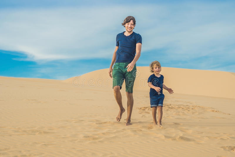 Father and son at the white desert. Traveling with children conc. Ept royalty free stock photography