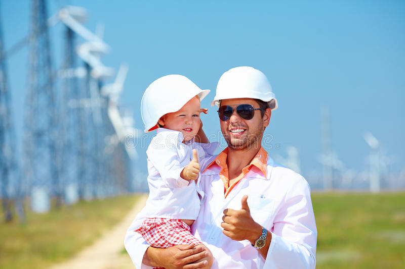 Download Father And Son On Wind Power Station Stock Photo - Image: 34119944