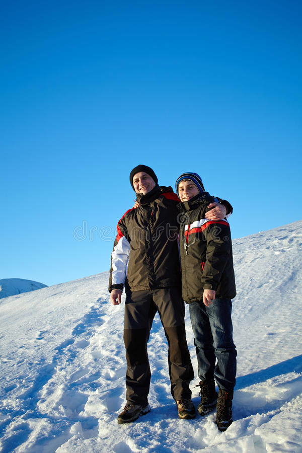 Father and son in winter holiday