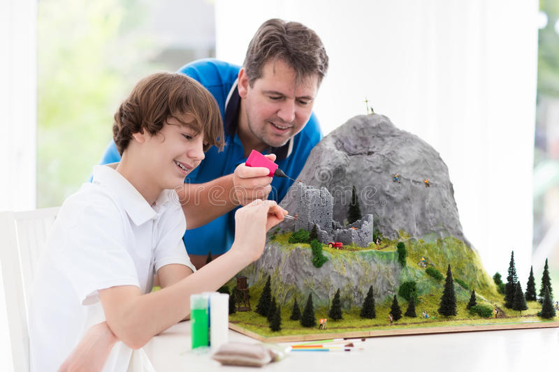 Father and son work on model building project stock image