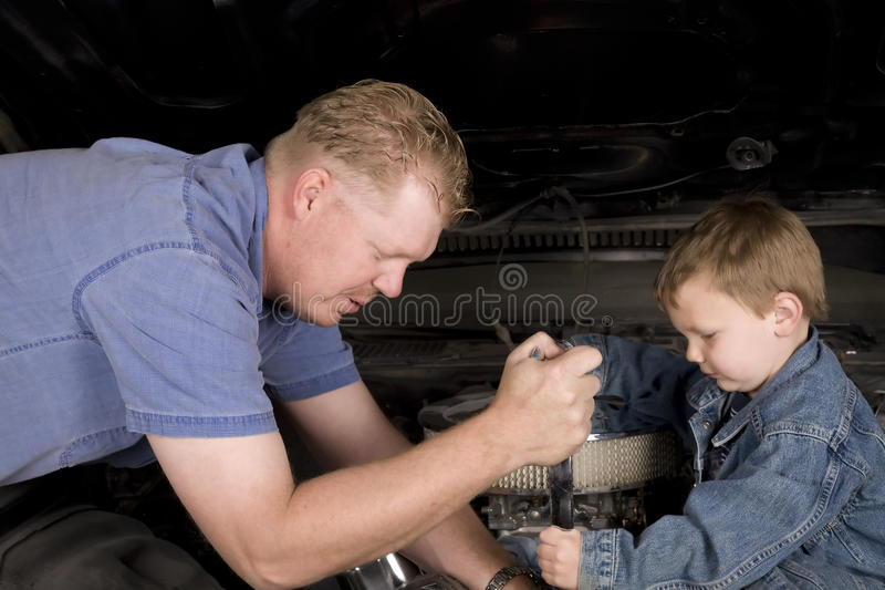 Father And Son Working Together Stock Photography