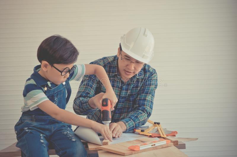 Father Son working together  for success in construction industry home repairing in vintage tone. For Family and parenting stock photos