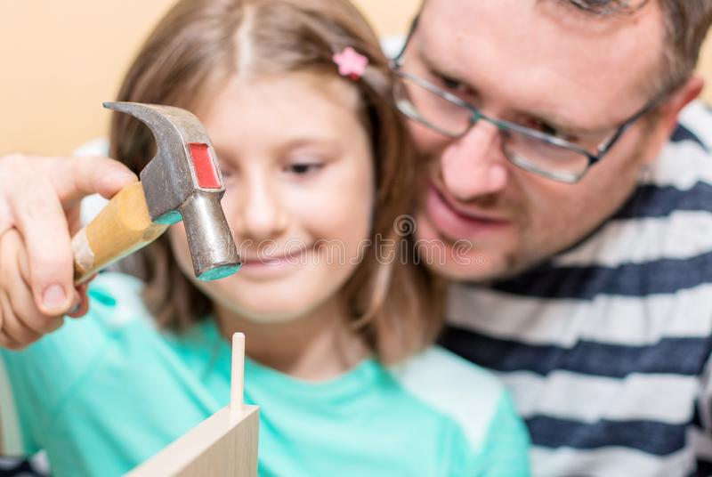 Father and sons are are building the furniture at home stock photo