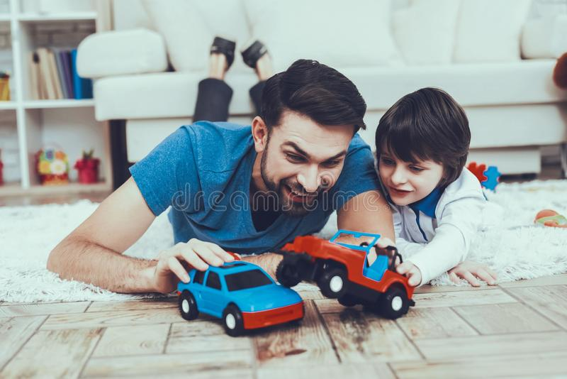 Father and Sons is Playing with Toys stock images