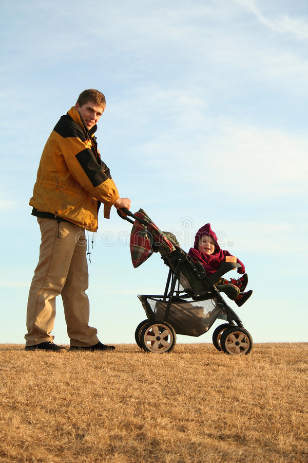 Father with stroller royalty free stock photography