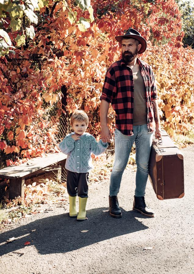 Father with suitcase and his son. Bearded dad telling son about travelling. Traveler with lot experience. Spirit of. Adventurism. Family time. Adventure with stock photography