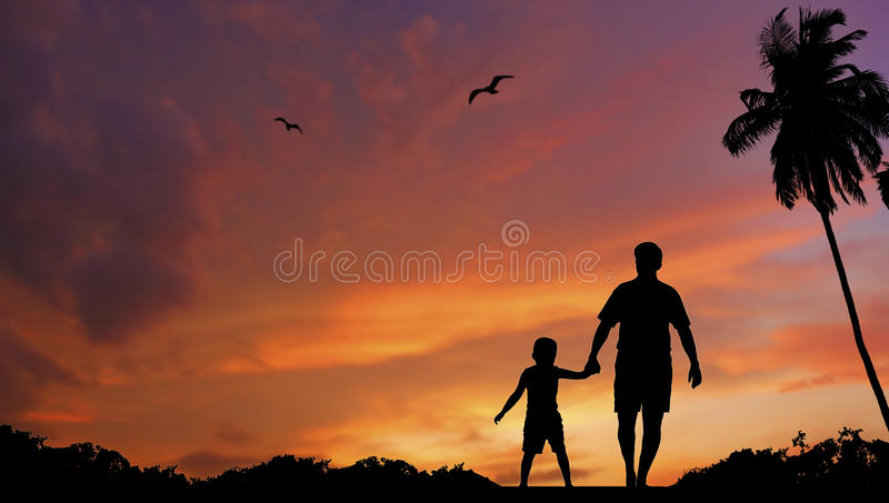 Father and sun walking together stock photos