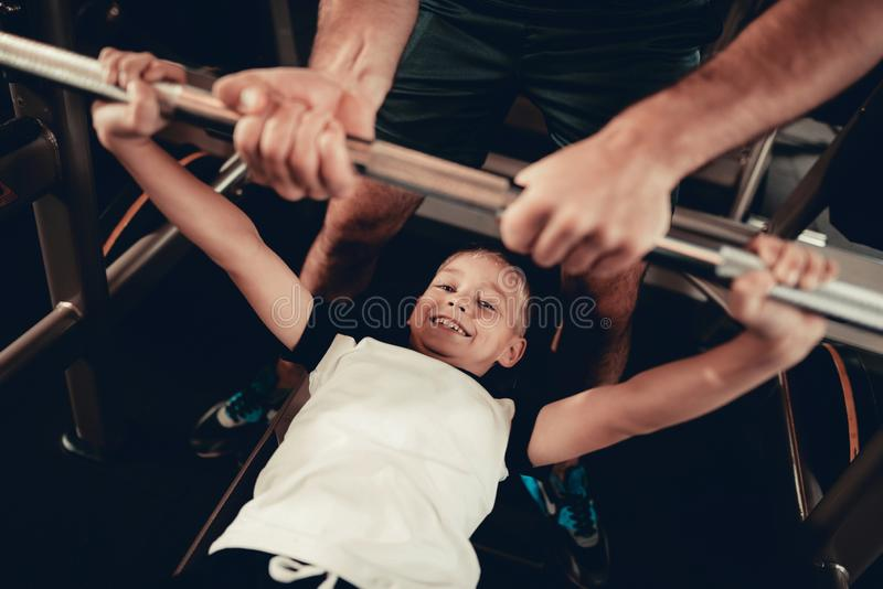 Father Support To Son While Lifting The Barbell. stock image