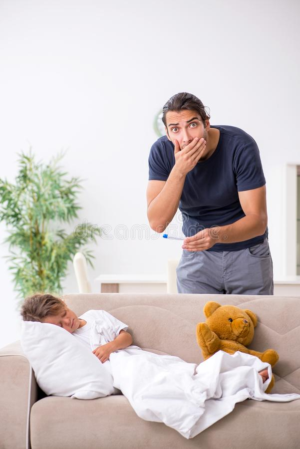 Father taking care of his ill daughter. The father taking care of his ill daughter stock image