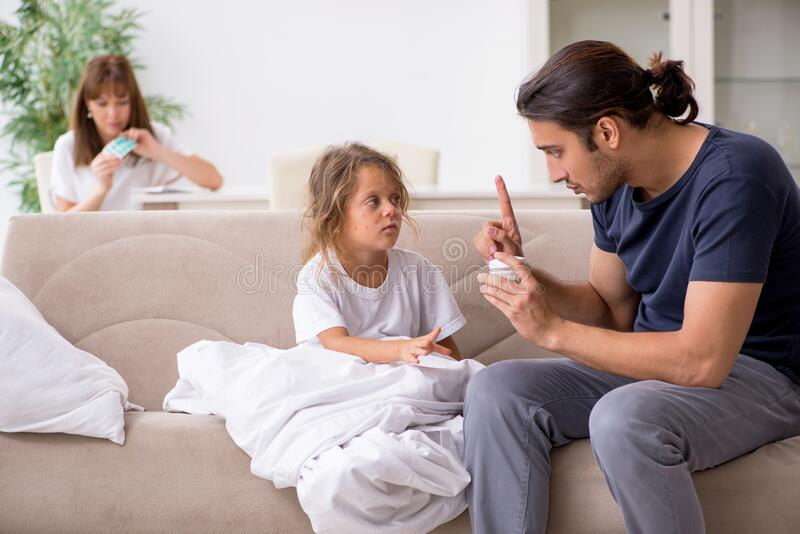 Father taking care of his ill daughter royalty free stock photo