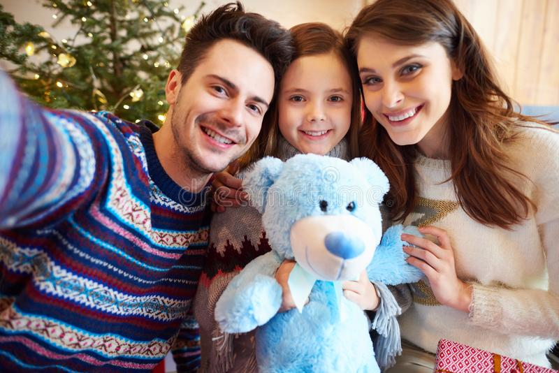 Christmas time with family. Father taking Christmas selfie of family royalty free stock image