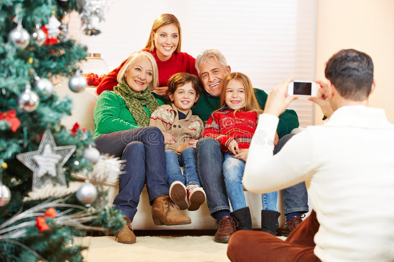 Father taking family picture royalty free stock image