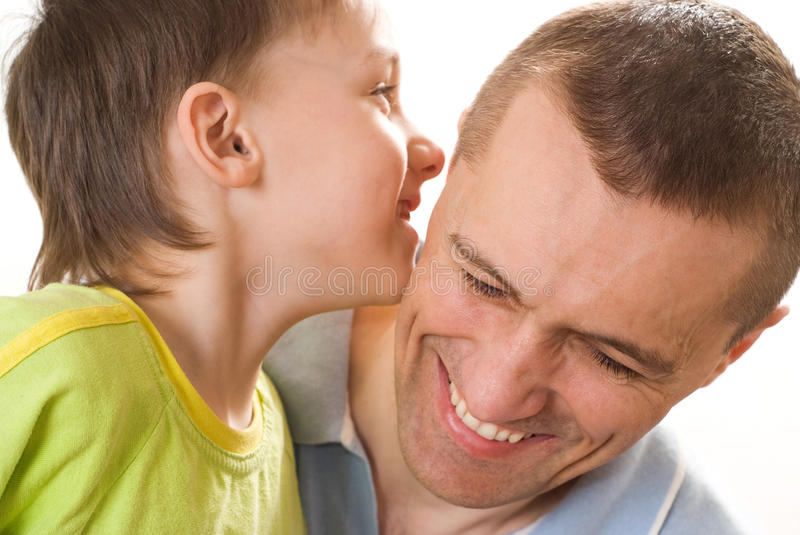 Father talking with his son. On a white background