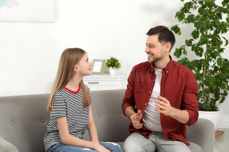 Father talking with his teenager daughter stock photo