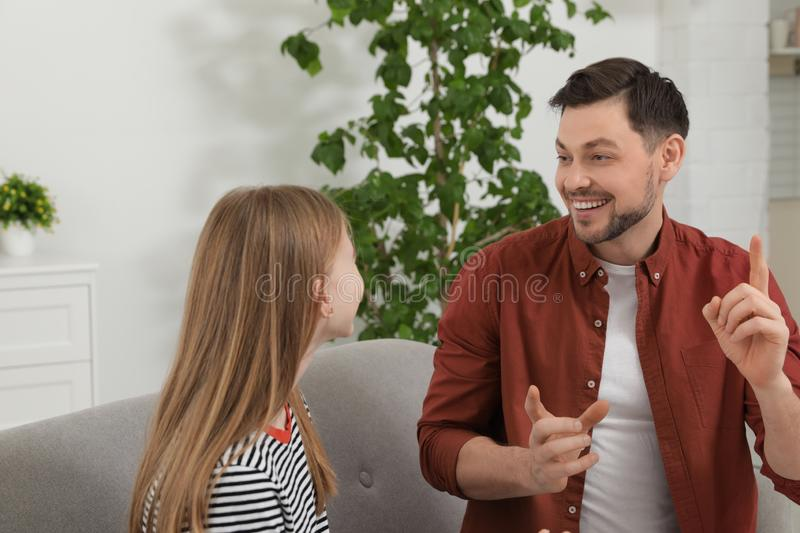 Father talking with his teenager daughter royalty free stock image
