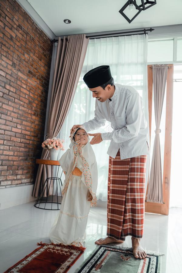 Father teach her toddler to pray royalty free stock image