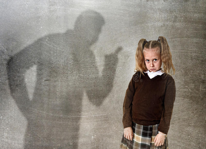 Father or teacher shadow screaming angry reproving young sweet l. Father or teacher shadow screaming angry reproving misbehavior to young sweet little schoolgirl stock photos