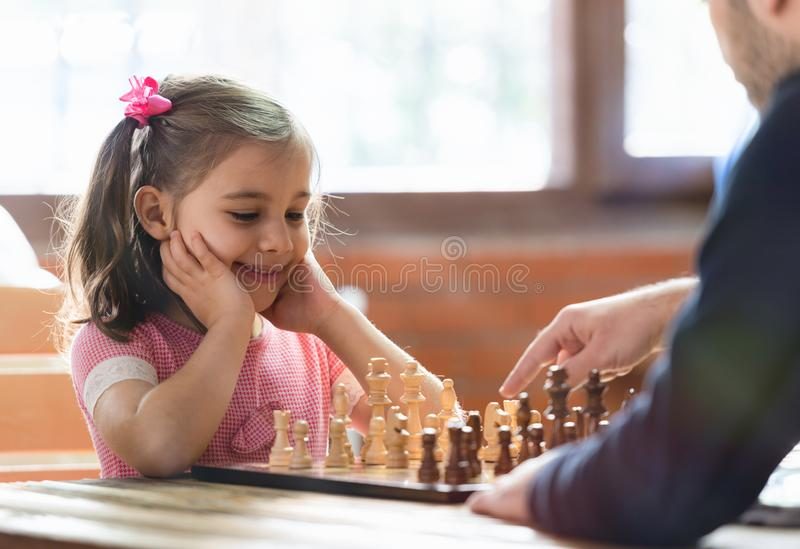 Father Teaching His Daughter to Play Chess royalty free stock images