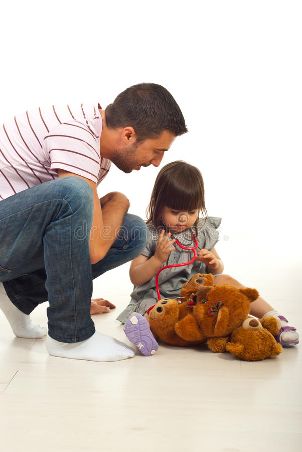 Father teaching his little daughter stock photography