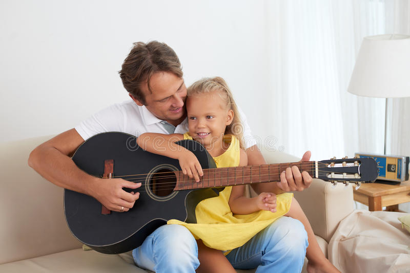 Playing guitar together royalty free stock images