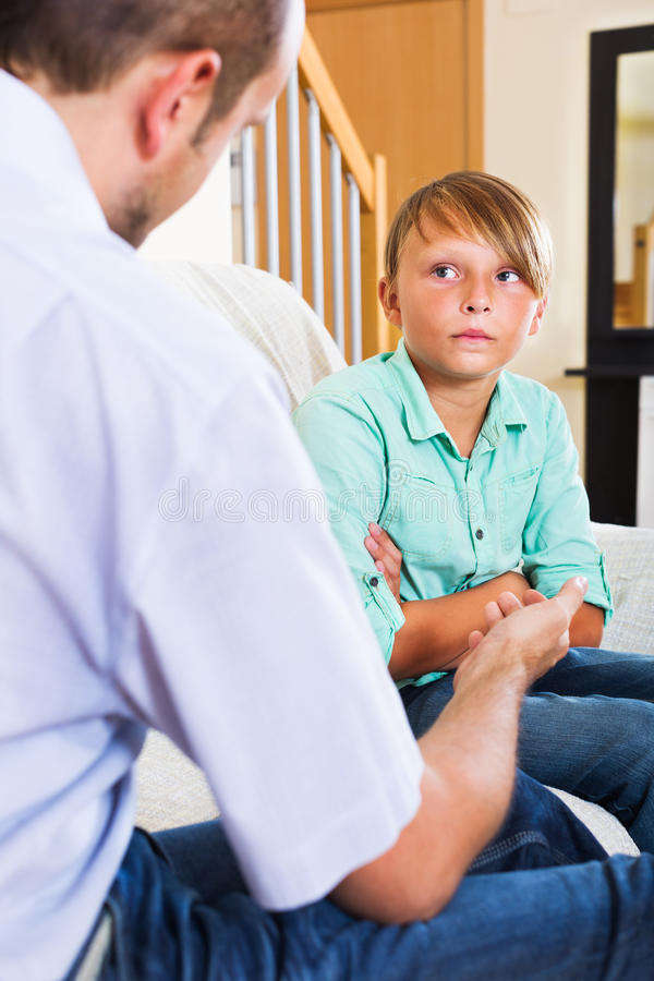Father and teenage son argue royalty free stock photo
