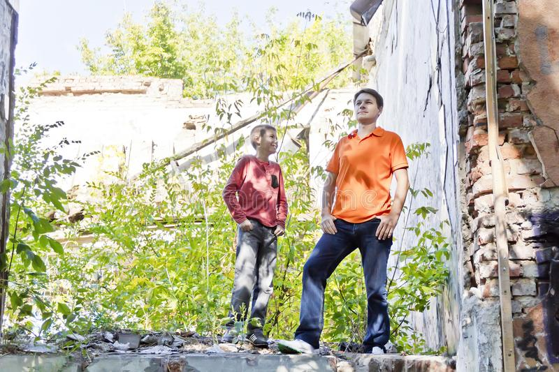 Father and teenager son in ruins stock photos