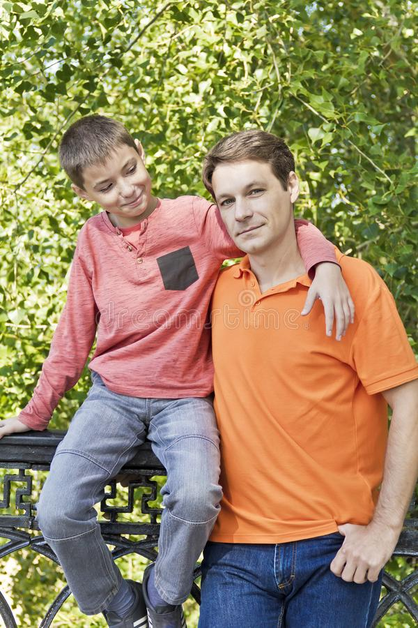 Father and teenager son together royalty free stock photos