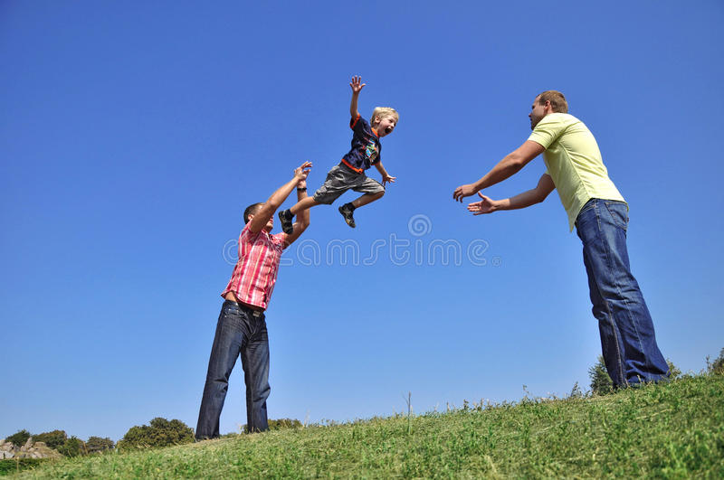 Download Father Throwing His Son In The Air And Catching Hi Stock Image - Image: 10917687