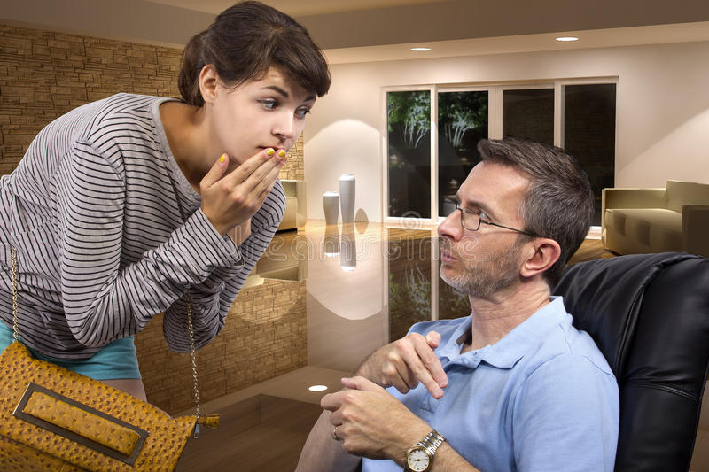 Father Tired of Waiting for Late Daughter at Night. Single father waiting for daughter to come home late at night past curfew stock photos