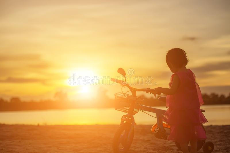 Father took the baby learn to walk at sunset royalty free stock photography