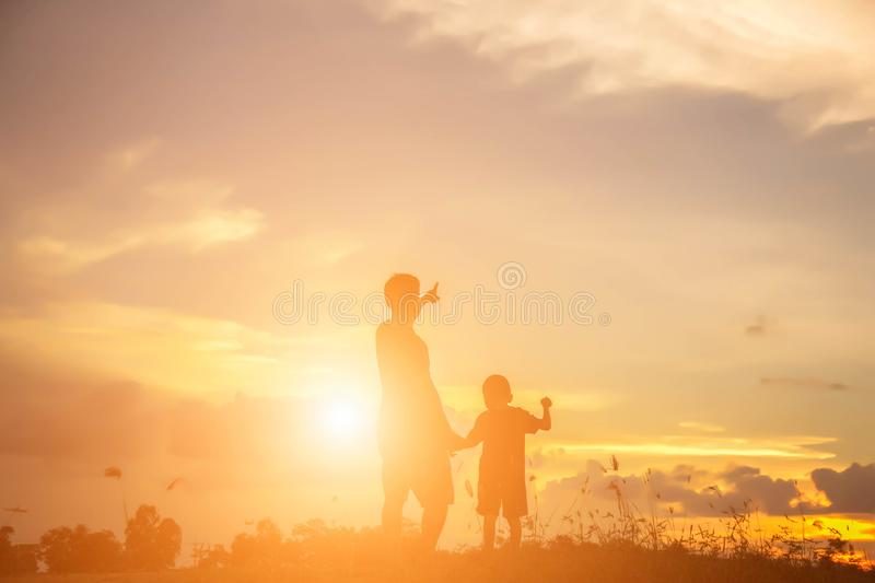 Father took the baby learn to walk royalty free stock image
