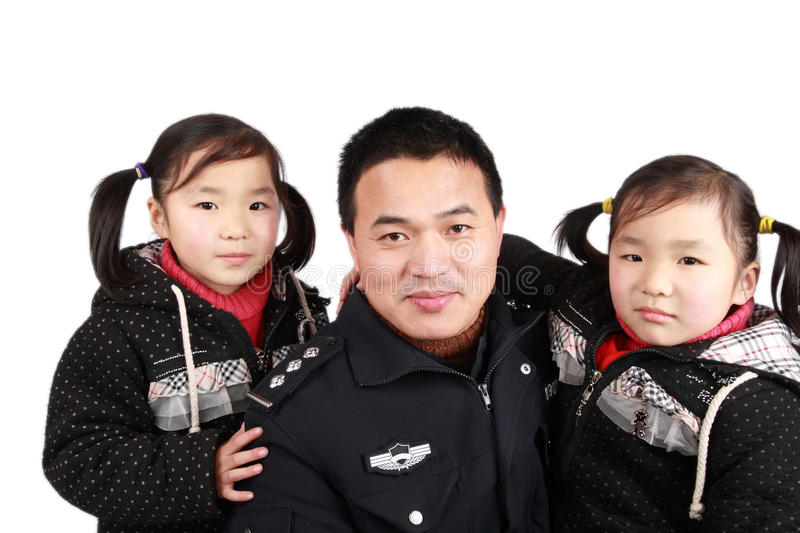 Father and twins daughters stock images