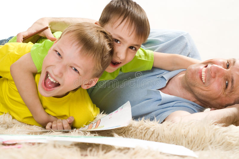Father and two brothers royalty free stock photos