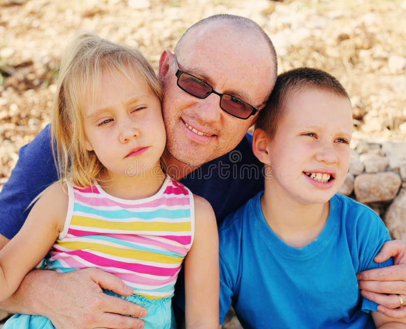 Father with two kids outdoors stock photo