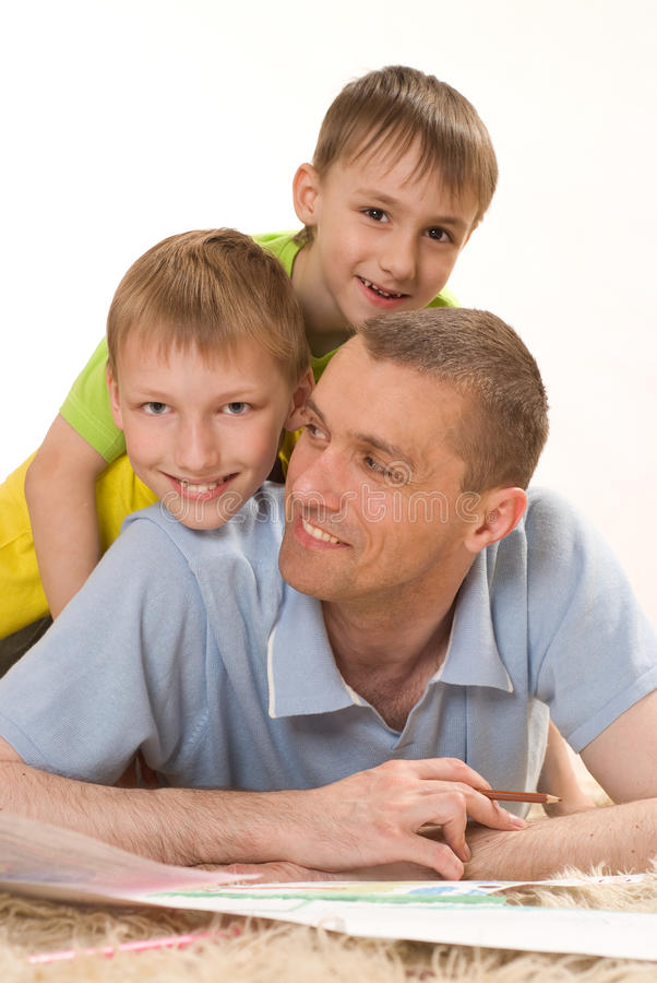 Father and two young brothers stock photo
