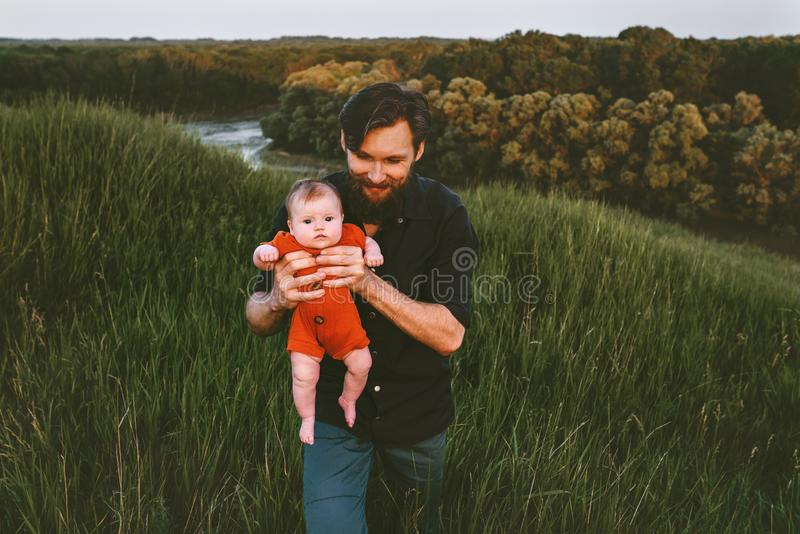 Father walking with infant baby outdoor royalty free stock image