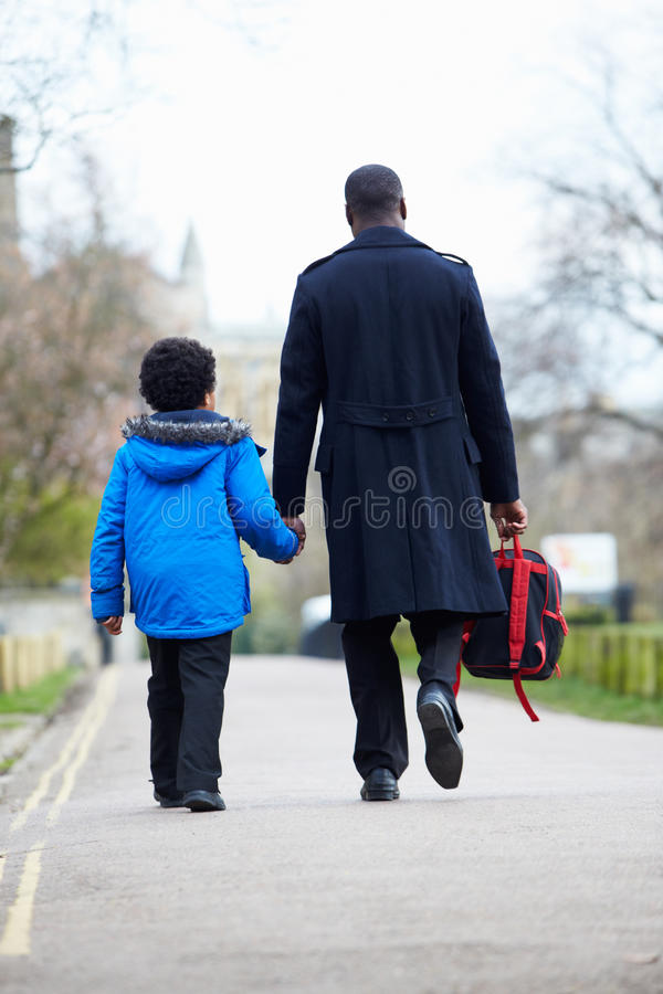 Father Walking Son To School Along Path royalty free stock images