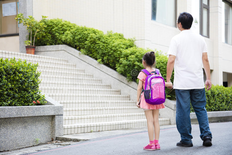 Father Walking To School With Children royalty free stock image