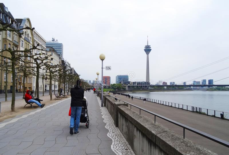 Father walks his baby at promenade, Dusseldorf stock photo