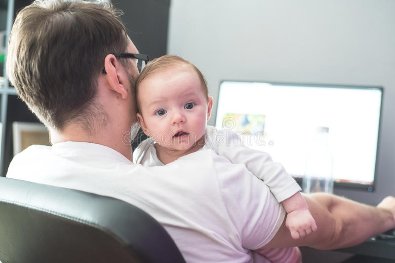 Father working from home royalty free stock images
