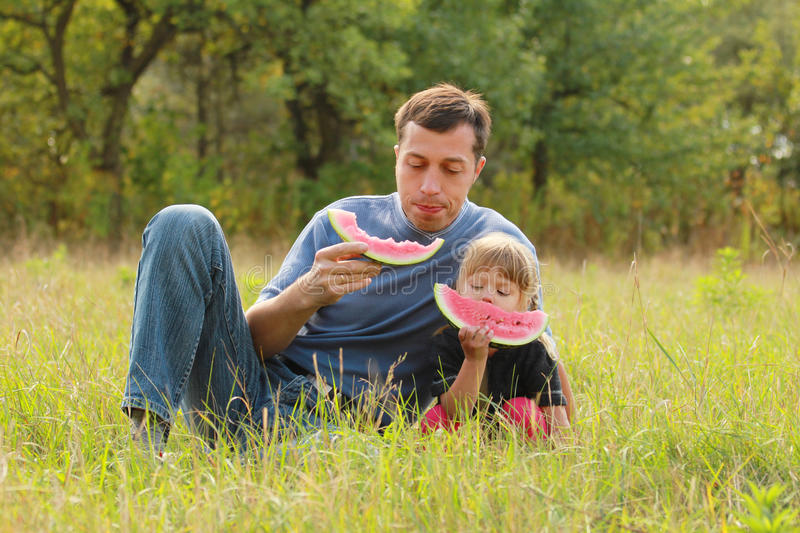 Download Father And Young Daughter Eat Watermelon In Nature Stock Image - Image: 33419579