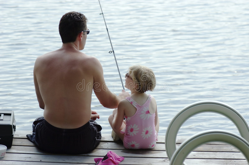 Father and young daughter fishing royalty free stock photos