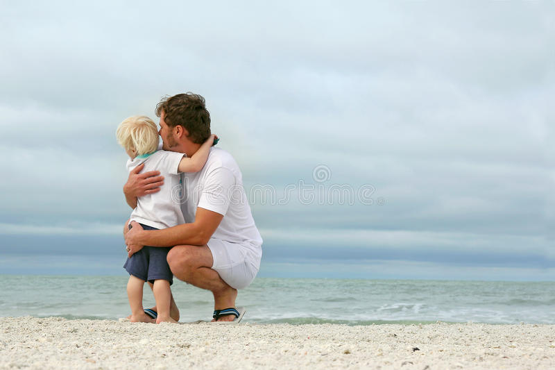 Father and Young Son Looking Out Over Ocean stock image