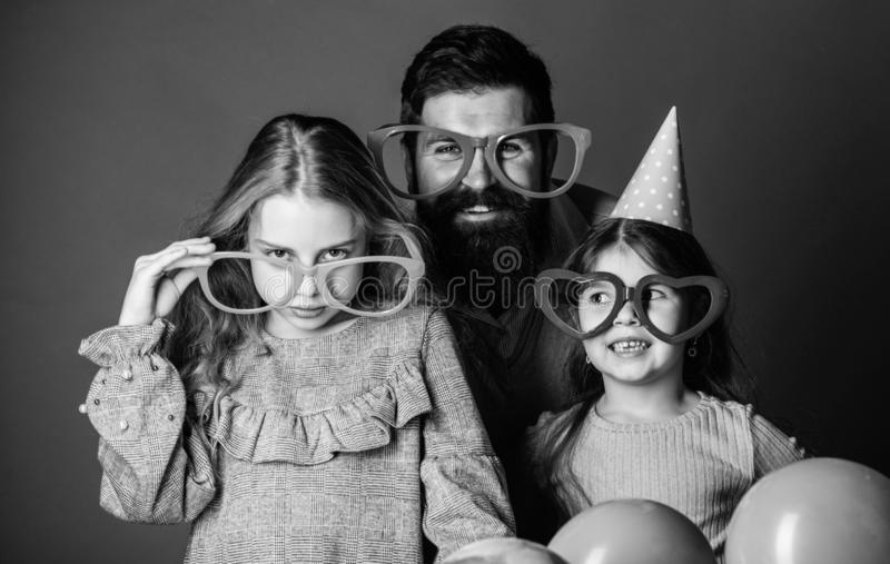 Fatherhood concept. Friendly family wear party accessories. Best dad ever. Fathers day. Daughters need father actively. Interested in life. Birthday party. Join royalty free stock photo