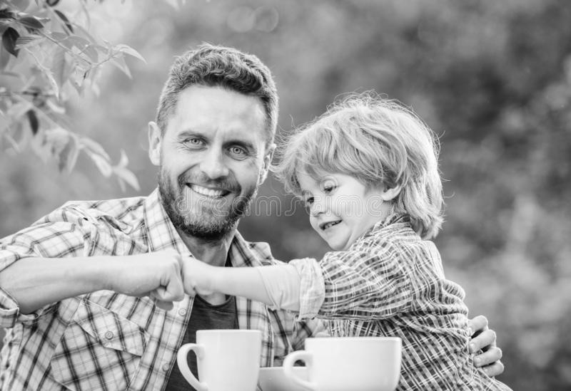 Fathers day. Best friends. Father and son having fun. Feeding son natural foods. Healthy food. Father and boy drink tea stock photo