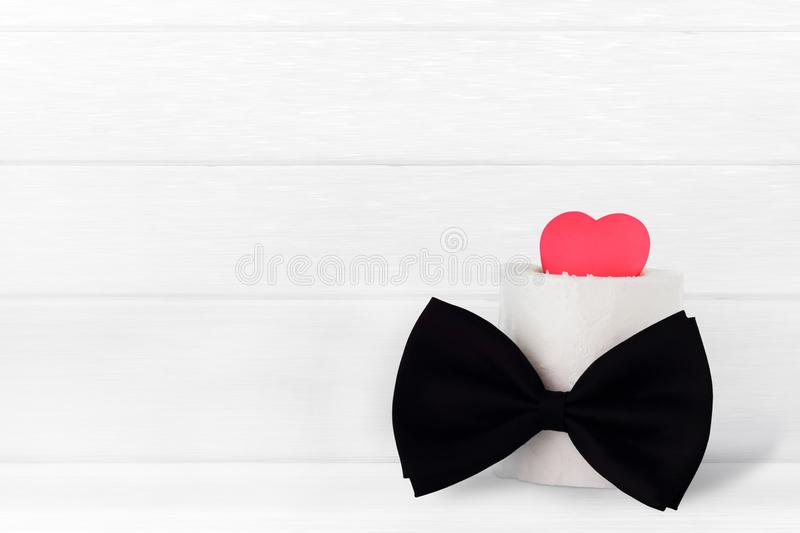 Fathers day / card - love heart with bowtie. On light wooden background with space for text stock photos