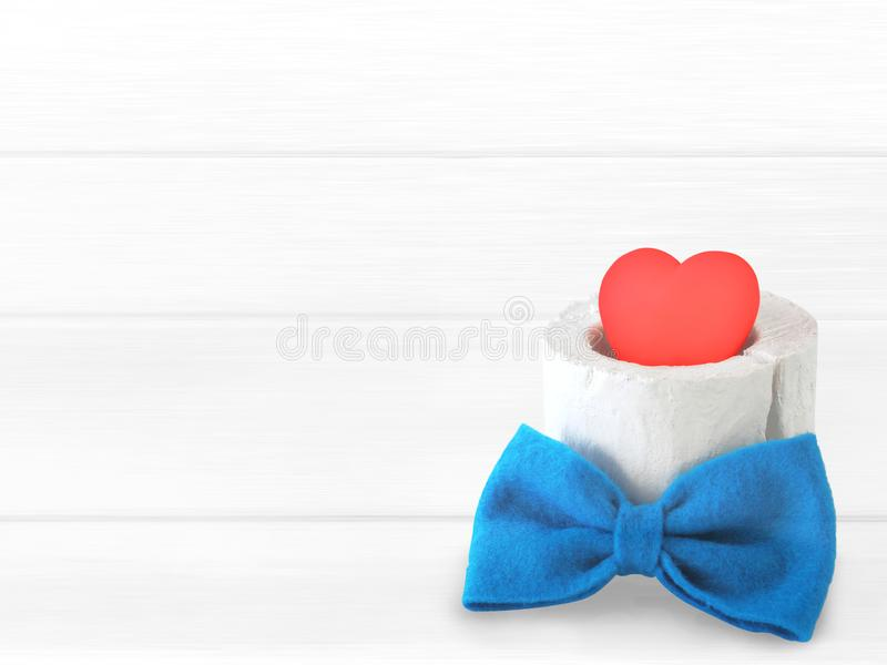 Fathers day / card - love heart with bowtie. On light wooden background with space for text royalty free stock photos
